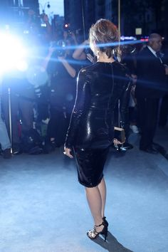 Gina Gershon Lookbook: Gina Gershon wearing Box Clutch (2 of 5). Gina Gerson's gold box clutch and LBD at the Tom Ford fashion show were a classic pairing!