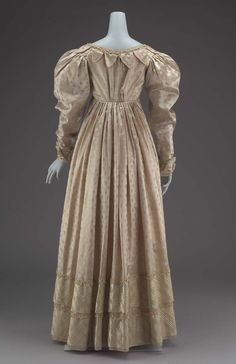 1825 Pale Pink, Figured Satin American Gown. (Image via Museum of Fine Arts Boston.)