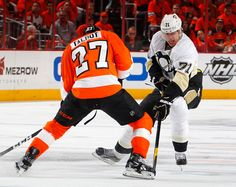 Evgeni Malkin #71 of the Pittsburgh Penguins is stopped by Maxime Talbot #27 of the Philadelphia Flyers