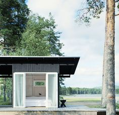 I would live in this lakeside tiny house in a heartbeat!