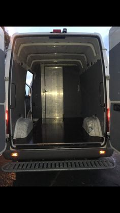 Mercedes Sprinter 316 back bench to stand on for shower with on demand hot water, hanging shower curtain and door ajar