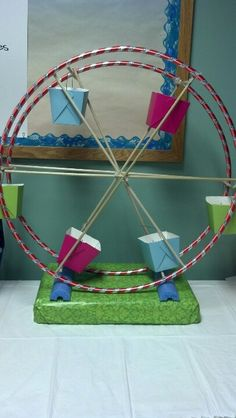 Carousel made of hula hoops, dowel rods, and Chinese take out boxes.