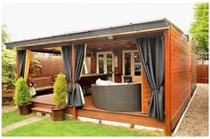 Create a she shed that's all about maximizing the outdoor space. Description from californiahomedesign.com. I searched for this on bing.com/images