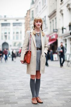 We Snapped 17 Stylish Londoners On Oxford Street #refinery29  http://www.refinery29.com/london-street-style#slide12  Name: LizzieOccupation: StudentHood: ClaphamWhat's she wearing: Warehouse coat, Asos shoes, Dress gifted from a friend, and Joy necklace.