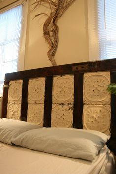 Door headboard accented by ceiling tiles. Find tiles for your next project at ceilume.com!