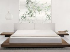 This contemporary Japanese platform bed includes low slung bedside tables.