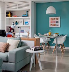 Colour, brick wall, eames chairs...just perfect