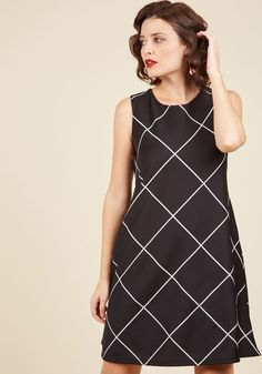 While this black shift dress has your focus sharp and your productivity soaring, you're never too busy to greet your great coworkers! With white gridlines and a silver back zipper, this slight-stretch dress does the work of offering a friendly appearance.