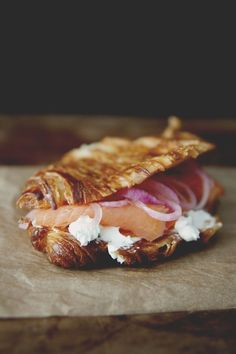 Griddled Croissant with Chive Cream Cheese, Smoked Salmon, and Pickled Onions.