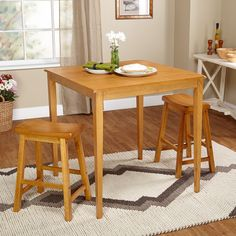 Complete your dining room with the Belfast 3-piece set including two stools and one table. Beautifully crafted of rubber wood, this set features a minimalist design that will transition well into any style of decor.