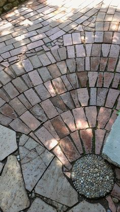 A homeowner/artist-in-residence created this beautiful walkway with common paving materials.