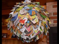 Pages from old books I got free at the recycling center cut into rectangles, folded to a point at one end and hot glued onto a discount store paper lantern. This was a favorite of our guests at the baby shower.