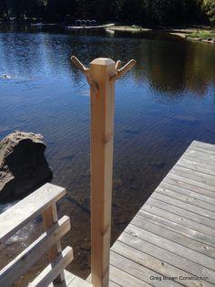 Simple Cedar towel hanger down on the docks.  4x4 cedar with rough cedar branches stuck into the top.