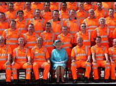 Queen Elizabeth II poses with construction workers