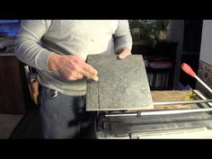 How To Cut Porcelain Tile-using a tile cutter - YouTube
