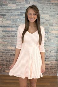 Front view a line dress with neon orange stripes