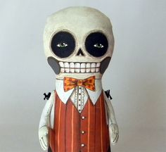 I love the things that Cart Before The Horse Makes.  Skeleton Day of the Dead Doll-- Original Contemporary Folk Art-- Made to order within 7 days. $90.00, via Etsy.