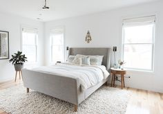 like the mix of patterns with the neutral color palette- maybe want a bit more color though- do NOT like a sleigh bed or any foot board that makes it hard to make up the bed