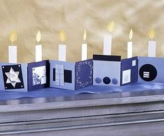 menorah inspired accordion card for mantel or tabletop. Decorate blue and navy squares with sliver accents, buttons, and wire.