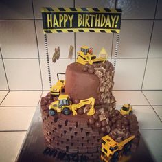 Construction boys birthday cake w/ front loader & dump truck