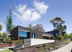Mt Martha Beach House by Wolveridge Architects is clad in a mixture of weather-resilient materials
