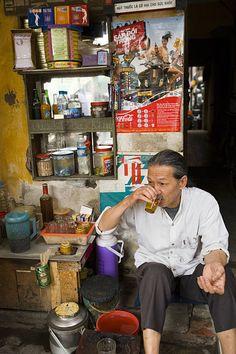 Man drinking tea, Old Quarter, Hanoi, Vietnam, Asia