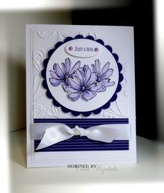 Pretty purple and white with cut out flowers and embossing