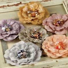 Embellished flowers with brooch centers