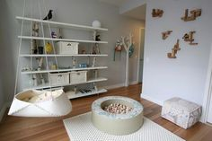 This is actually a baby's room in a home but there is a lot of inspiration for a school setting as well: Hanging Bassinet, Finnish Tree Hook, Birch Branch Shelves and neat Toy Block Display Shelves.