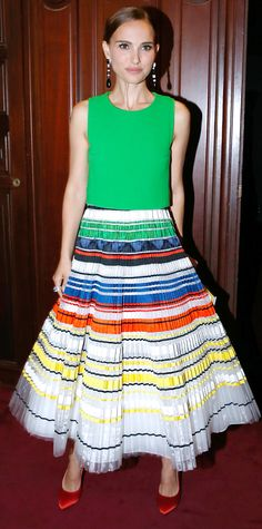 Natalie Portman hit the Ballet National de Paris Opening Season Gala in a stunning Dior Haute Couture number, featuring a bright green top and an exquisite pleated embroidered multi-colored ribbon skirt, in which she styled with statement drop earrings and red satin pumps.