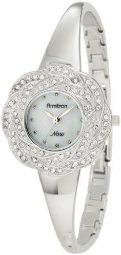 Armitron Women's 75/5007MPSV Swarovski Crystals Accented Silver-Tone Floral Bangle Watch Armitron. $37.50. 72 clear genuine swarovski crystals set in bezel for sparkling finish. Round polished silver-tone case with beautiful floral petal designed bezel. Silver-tone hour, minute and stick second hand. Polished silver-tone finished bangle with adjustable bracelet links and jewelry extender. Genuine mother-of-pearl dial  with silver-tone pearling markers at all hours