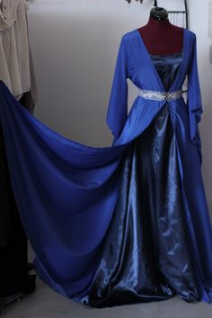 This listing is for 2 pieces dress. The inside one in dark blue satin and the top one in poliester crepe. Is adjusted underbust with a silver trim