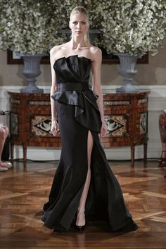 This Romona Keveza evening gown is daringly dramatic, yet still romantic