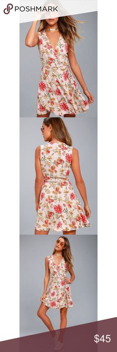 🆕Best In Bloom Blush Floral Print Wrap Dress Flirty and cute, the Best In Bloom Blush Floral Wrap Dress has it all! Woven rayon, with a lovely red, green, and white floral print, shapes a sleeveless, wrapping bodice with tying sash belt, and flirty skater skirt. Unlined. 100% Rayon. Hand Wash Cold. Imported. Lulu's Dresses Mini