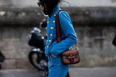 Yoyo Cao wearing a Gucci denim jacket and Gucci bag after a fashion show in Paris, France