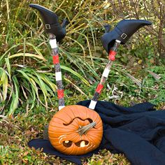 This Halloween speed demon made a rough landing, but re-creating her is a breeze with witchy wardrobe items and stocking-striped sticks. Her hat, shoes, and cape can be found online or at theatrical shops. Simple sticks or dowel rods make great legs for the silliest pumpkin on the block.