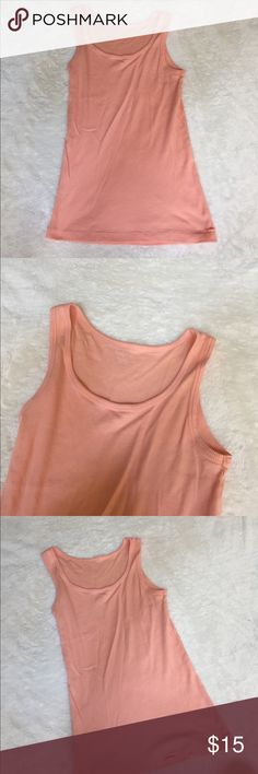 Peach Calvin Klein Tank Top Great condition. Size medium. 100% cotton. This item comes from a smoke free home. I usually ship same day or next! Calvin Klein Tops Tank Tops