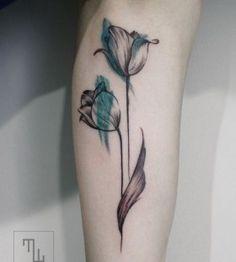 Black and blue tulip tattoo