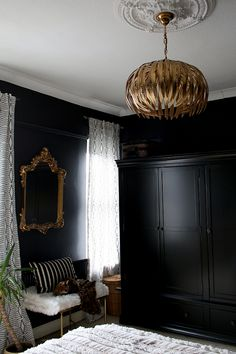 gold ceiling light in black bedroom with geometric curtains boho glam