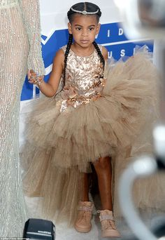 Little princess: Blue Ivy was adorned like a child from a Disney fairy tale with that sparkling tiara on top of her head
