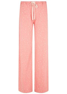 STARS PYJAMA TROUSERS IN CORAL Coral pyjama trousers with star print in certified 100% organic cotton. Soft, comfy pyjama trousers with contrast drawstring. Also available in navy. Length 81cm.