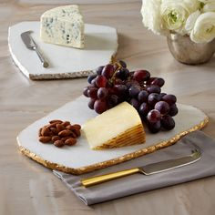 White Marble Cheese Set with Metallic Edging Includes Board and Knife in Black Suede Pouch Assorted 2 Colorways: White/Gold Leafing and White/Silver Leafing -Marble/Stainless Steel/Brass