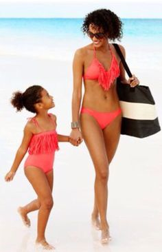 Pink matching swimming suits for mother and daughter