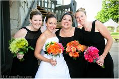 Bridesmaids in green, pink & orange with the bridal bouquet carrying all three colors! <3