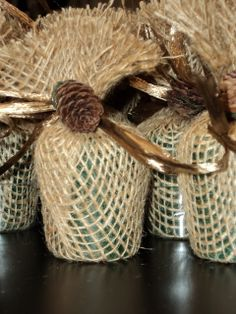For favors,  wrap evergreen scented candles in burlap with small pine cone
