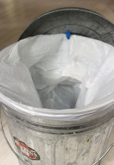 Use Sugru to add a hook to your trashcan lid, so you can hang it on the side of the trashcan.