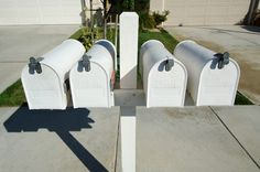 How to Build a Double Mailbox Post.  Simple 4x4 post and you could add a decorative finial on top.