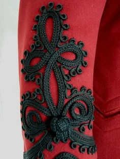 Close up of passementerie, embroidery, appliqué, black embellishments on the cuffs of this beautiful red Victorian jacket, ca. 1898 from antique-gown on Ruby Lane Motif Soutache, Soutache Pattern, 1890s Fashion, Steampunk Fashion, Victorian Fashion, Victorian Coat, Silk Ribbon Embroidery, Hand Embroidery, Embroidery Designs