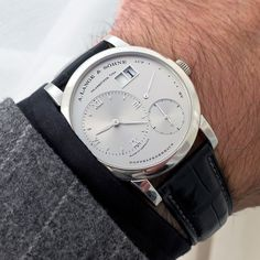 A. Lange & Söhne 1 Wristwatch Movement: Calibre L901.0. Manually wound. 72 hours power reserve. Patented outsize date. Dial: Solid silver, champagne. Hands: Withe gold. Case: Diameter 38.5 mm. Height 10.0 mm. Sapphire-crystal glass and caseback. Hand-stitched crocodile strap