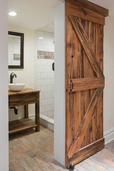 Contemporary 3/4 Bathroom with Weathered barn door, Chicago Common Brick Flooring, limestone tile floors, Barn door